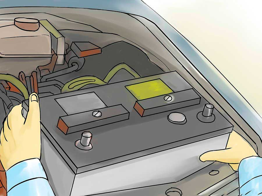 Механик извлекает аккумулятор из автомобиля